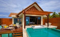 Modern Resort for Your Getaway in Maldives : Wood Pergola Thatched Roof Exterior Swimming Pool Stylish Chaise Lounge Chairs Bali, Water Villa, Overwater Bungalows, Maldives Resort, My Pool, Wooden Pergola, Private Pool, Pool Designs, Hotels And Resorts