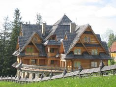 Wooden countryside home in Zakopane, Poland. I wouldn't want something this huge, but it's pretty.