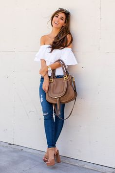 "The Darling Detail wearing a white Topshop Poplin Bardot Top with AG ""The Legging"" Ankle Jeans and Steve Madden ""Kierra"" Platform Sandals—and holding the Chloe Marcie Leather Satchel."