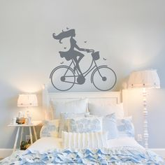 Share us on your network of choice and get 10% off your order! Lady on a Vintage Bike Wall Decal