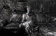 Plastic covered room.  spooky.