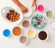 DIY your own donut by dipping in your frosting of choice and topping with sprinkles.