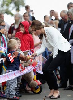 Kate shook hands with the youngsters who had lined the streets to see her - and even took ...
