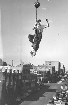 Swinging high above a street, rigger Jack Farley directs his invisible crane driver to lower him to a pile of girders on a building site in Spencer St. West Melbourne, Melbourne Victoria, Victoria Australia, Melbourne Australia, Back In Time, Back In The Day, Great Photos, Old Photos, Terra Australis