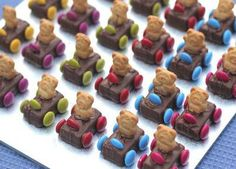 Super easy and cute idea from  What's on 4 Little Ones - Australia. Teddy Grahams stuck in candy bar cars with  Skittles (or your disc-shaped candy of choice) for wheels and steering!