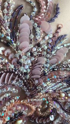 Pinned from Viktoria Boyko. Stunning emboidery with beads and sequins. The pastel color range is so delicate and I love the resemblance to an abundant flower field.mentions J'aime, 11 commentaires - fashion embroidery Tambour Beading, Tambour Embroidery, Couture Embroidery, Bead Embroidery Jewelry, Embroidery Fashion, Embroidery Applique, Beaded Embroidery, Embroidery Stitches, Couture Beading