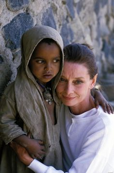 """""""As you grow older, you will discover you have two hands; one for helping yourself, the other for helping others.""""-Audrey Hepburn in Somalia, 1992, only a few months before her death from cancer."""