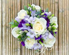 Purple and lilac bouquet of roses , lissianthus and freesia