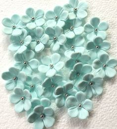 36 soft blue blossom silver edible fondant flowers cupcake cake toppers decoration hawaiian tropical sweet 16 wedding Easter by InscribingLives (18.99 USD) http://ift.tt/1WKUIoy