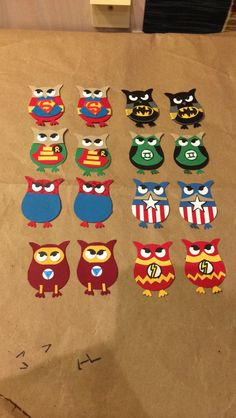 8 different types of superhero owls. All made using stampin up. Perfect size for cards. Superman. Batman. Robin. Green lantern. Captain America. The flash. Spider-Man. Iron man.