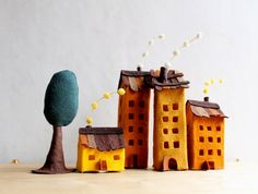 Four buildings of felt with a tree Miniature Decoration by Intres, $35.00