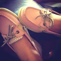 Totally thought the sperrys had teeth and were eating her feet.  C'mon, look at those little evil eyes!!