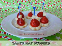 Santa Hat Poppers - perfect kids finger food for a Christmas party!  (by creativekidsnacks.com)