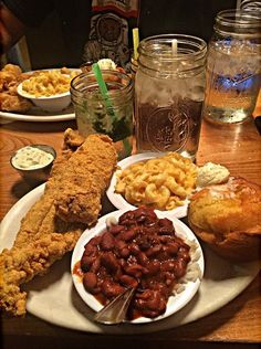 Fried fish catfish with tartar sauce, a side of red beans and rice Mac and cheese and bread with whipped butter