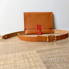 Cognac leather fanny pack / belt bag with red leather detailing