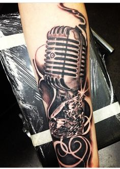 Old school microphone and diamond tattoo