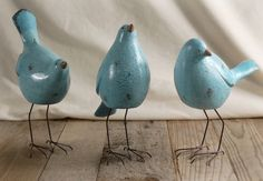 Three blue birds
