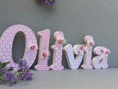 A personal favourite from my Etsy shop https://www.etsy.com/uk/listing/287925119/decorated-wooden-names-baby-girl-nursery
