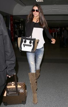 Celebrity Street Style - Kendall Jenner Highlights Lean Legs With Distressed Denim At LAX