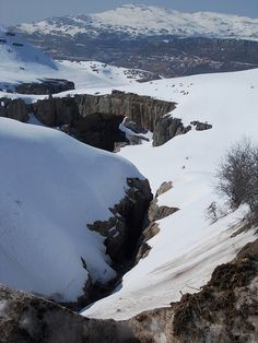 Snow and natural bridge, over Faraya, Lebanon. Mzaar Kfardebian (formerly Faraya Mzaar) is a ski area in Lebanon and the largest ski resort in the Middle East. It is located one hour away from Beirut, the capital of Lebanon. (V)