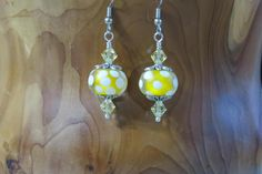 Frosted Lampwork Earrings Yellow Center Clear Outer Glass White Dots Pale Yellow Swarovski Crystals antiqued silver bead caps top and bottom by NammersCrafts on Etsy