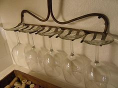 this is such a dope idea for a wine glass rack. I have to go back and find the source, but i have to try this.