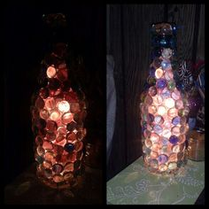 DIY Bottle lamp. made for an old alcohol bottle use clear rock glued onto it. And Christmas lights