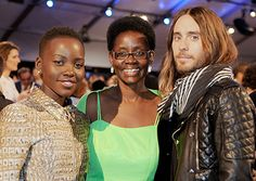 Lupita Nyong'o, mother Dorothy Nyong'o, and actor Jared Leto pose during the 2014 Film Independent Spirit Awards at Santa Monica Beach on March 1, 2014.