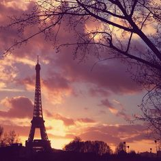 A dramatic winter sunset engulfs the Eiffel Tower.