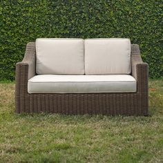 Montclair Wicker Loveseat | Built to last and look great at the same time, the Montclair Loveseat showcases beautiful woven wicker and high waterfall arms. Fitted with soft cushions finished with welted trim, it offers a chic spot to gather with friends or your latest summer read.