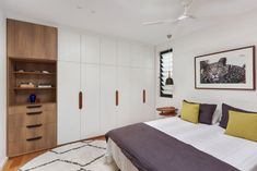 Stunning individually designed floor to ceiling wardrobe. Braeside Joinery was thrilled to create unique wardrobe & cupboard designs for each townhouse in-keeping with the natural timbers, clean lines and coastal vibe.  This bedroom features quality joinery, with luxurious timber features and built in shelving & drawers. Drift is a stunning luxury beachside development in Sydney's Northern Beaches.