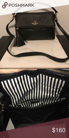Kate Spade Chester Street Miri Crossbody Bag Black pebbled leather with gold accents. Black and white striped lining. The flap that folds over also unzips and the zipper has a cute tassel attached. One short strap and a crossbody strap that is detachable. Great condition, practically no wear and is actually still a little stiff because it's been used so little kate spade Bags Crossbody Bags