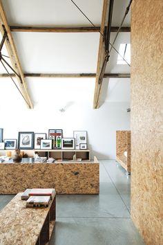 minimalist barn interior, OSB walls/furniture / designed by architect Carl Turner & Mary Martin