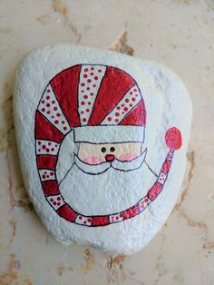 >>> PAINTED ROCK - Santa <<< This darling Santa Claus is wearing his favorite hat.striped with lots of cute polka dots! Perfect Secret Santa gift or stocking stuffer. Painted rocks come in many different styles and are a fun gift. Rock Painting Patterns, Rock Painting Ideas Easy, Rock Painting Designs, Pebble Painting, Pebble Art, Stone Painting, Painting Art, Painted Rocks Craft, Hand Painted Rocks