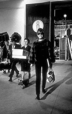 """33-2328 Audrey Hepburn part of a fashion layout photographed on the set of """"Paris When It Sizzles"""""""