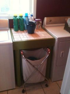 project laundry folding table and sorter underneath like pottery barn type chuny sturdy with three layers of paint treatment aug 2013.jpg