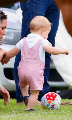 Prince George had some practice kicking a soccer ball – with mommy's help – in 2014.  Photo: Getty Images