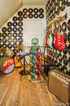 Use old records and guitar rack to decorate a wall