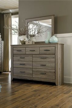 Coastal Bedroom Decor: Zelen Dresser by Signature Designs at Kensington Furniture. Having 9 extra drawers of storage is perfect for keeping bedroom organization.