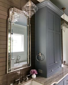 Classic master bathroom with a twist courtesy of Molly Singer Design featuring Tableau Medium Pendants by Kelly Wearstler in Antique-Burnished Brass and Clear Glass Rustic Bathroom Vanities, Shiplap Bathroom, Vintage Shelving, Blue Kitchen Cabinets, Bathroom Cabinets, Bathroom Plants, Bathroom Hacks, Bathroom Ideas, Primitive Bathrooms