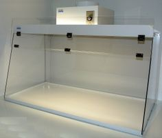You may need this higher clearance Ducted Fume Hood -> http://www.laboratory-supply.net/exhausthoods/ducted_fume_hood_high_clearance.html