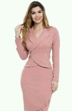 Vert pretty Salmon/peach 2 pc suit. Side buttons ate figure flattering