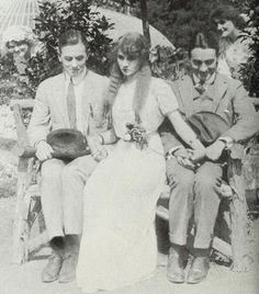 """Florence Lawrence is caught in the middle of a romantic triangle with Matt Moore (left) and Owen Moore, in the 1912 film, """"Tangled Relations."""""""