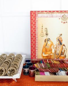 This couple set up a little bazaar where guests could pick up bangles and bindis, as is tradition for the hosts to provide these items for their guests to wear at the wedding.