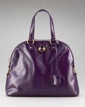 I owe the brown one - I think I need to add this one to my bag collection. :)