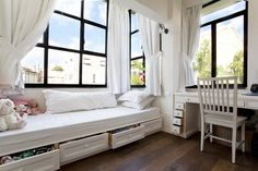 storage and a beautiful bench in a child's bedroom