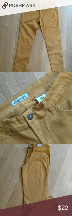 Emperial Skinny Jeans. Beautiful gold Awesome stretch skinny jeans in a beautiful gold color. New without? tags. Cotton and? spandex blend for comfort. Size 10 emperial Jeans Skinny