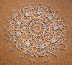 IdahoCanuck's lovely doily.  (Intatters)  Probably the most beautiful doily I've ever seen.