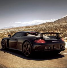 Badass Black #Porsche Carrera GT. A super rare find. Click on the image to check it out today. #SupercarSunday