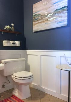 black flooring Crisp white DIY wainscoting and a striking, deep blue wall color elevate a formerly dull powder room. Find out how a few key projects and styling from Design Sponge make this a budget bath makeover. Bad Inspiration, Bathroom Inspiration, Bathroom Renos, Small Bathroom, White Bathrooms, Luxury Bathrooms, Master Bathrooms, Dream Bathrooms, Bathroom Faucets